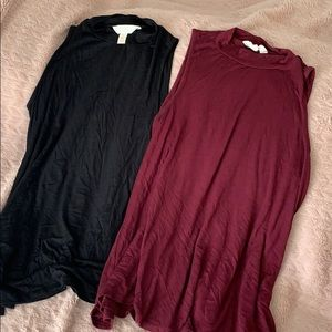 TWO high-necked tank tops